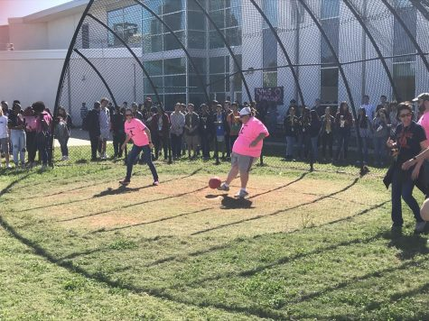 Ms. Schmidt striking out, ending the 2nd inning of Carnegie's first Breast Cancer Kickball Game
