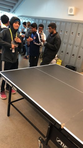 Students wait in line to get a chance to show their skills during Ping Pong club.