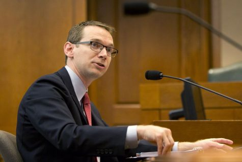 TEA Commissioner Mike Morath announces the takeover of HISD at a State Capitol hearing.