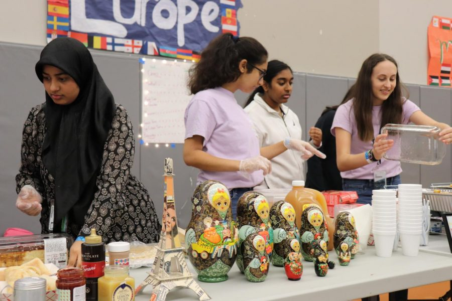 Student serve food during the 8th Annual I-Fest Celebration.