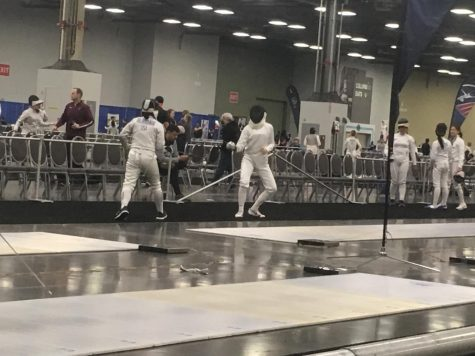 Monica Balakrishnan fencing with her opponent at the convention center.