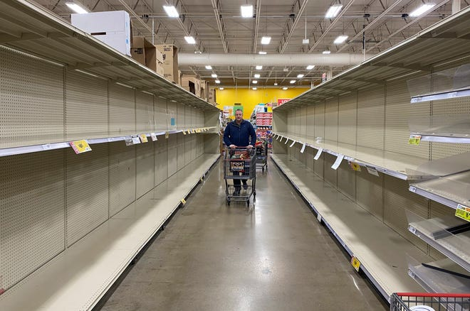 Shoppers find empty shelves and a desolate environment at HEB grocery store.