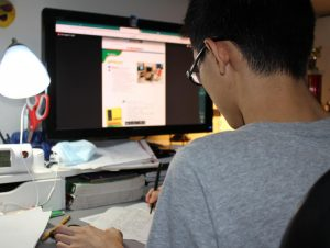 Since schools have closed, students, like Vincent Huynh, have been required to participate in online classes.