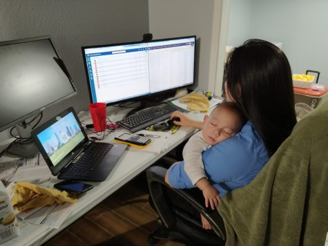 Calculus teacher Stephanie Chen continues communicating with students online while her 6-month-old son Jacob sleeps in her arms.