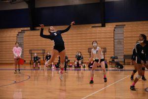 Varsity volleyball captain Li Bahler going for an attack against Debakey High School this season.