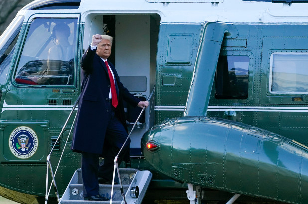 President Donald Trump boards Marine One as he departs the White House.