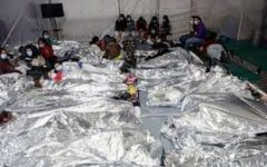 Migrant minors line up to sleep inside a detention center in El Paso, TX.