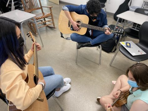CVHS juniors Katherine Linares and Lily Hurysz and sophomore Caitlin Liman jam during their free time at CVHS.