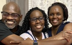 CVHS junior Barbara Butali and her parents warmly embrace as they celebrate their fully vaccinated status as of February 2021. (Photo courtesy of Barbara Butali)