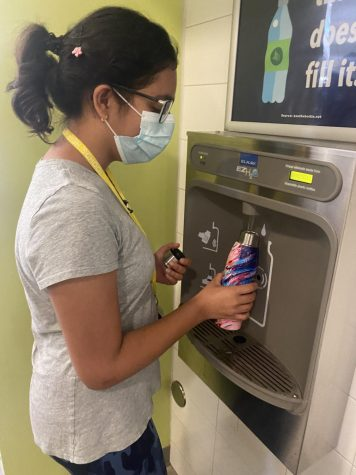 Sophomore Bela Jotwani uses a re-usable water bottle at a CVHS refilling station before cross country practice.