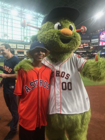 Austin Gordon standing next to Orbit after throwing the first pitch.