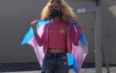Trisha Young poses with the transgender pride flag during CVHSs celebration of National Coming Out Day.